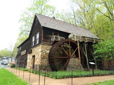 The Meadow Run Grist Mill Marker to the right. image. Click for full size.