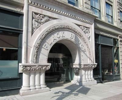 Flack Block - grand stone entry arch image. Click for full size.