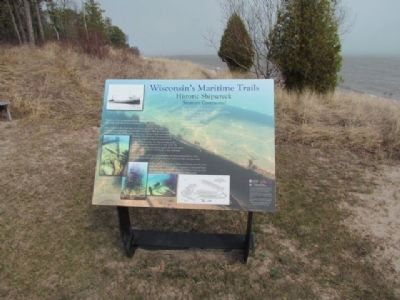 Marker and Lake Michigan shoreline. image. Click for full size.
