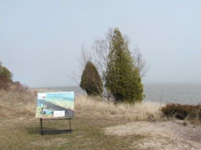 Marker with shoreline in distance. image. Click for full size.