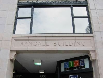 Randall Building - terra cotta paneling with building name image. Click for full size.