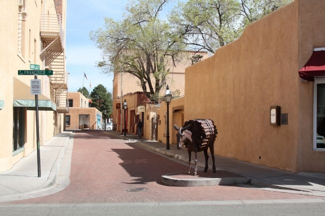 "Burro Alley, ""Homage to the Burro"" Statue and Marker (on wall) image, Touch for more information"