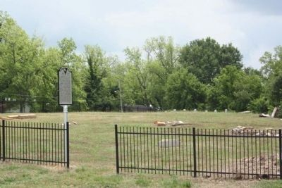 Newberry Village Cemetery Marker at entrance with Military Headstones in far background image. Click for full size.