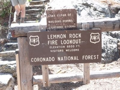 Sign at bottom of stairs leading up to lookout tower. image. Click for full size.