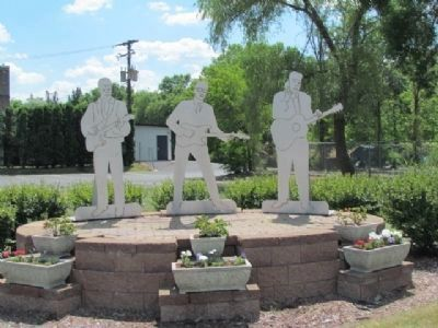 "Nearby Memorial to Buddy Holly, Ritchie Valens and J. P. ""The Big Bopper"" image. Click for full size."