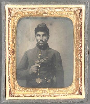 African American soldier, half-length portrait, with pistol and jacket image. Click for full size.