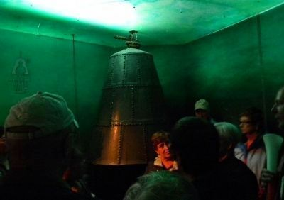 Tourists examine a 17th Century diving bell on display in the museum image. Click for full size.
