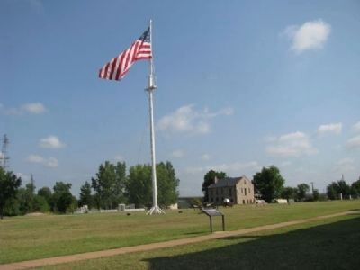 Fort Smith parade grounds and historic commissary storehouse image. Click for full size.