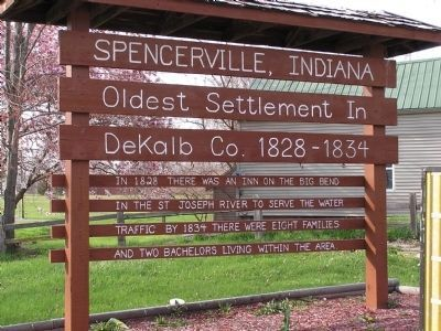 First Settlement in 1828 Wood Sign Located West of Marker image. Click for full size.
