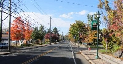 Looking west along Lake Road E. St. Paul's Church Marker visible on right. image. Click for full size.
