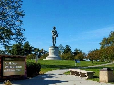 Orpheus statue (Francis Scott Key Memorial) with marker in the foreground at Fort McHenry image. Click for full size.