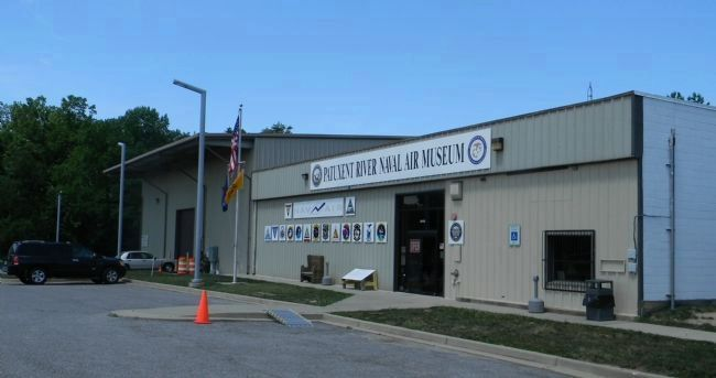 Patuxent River Naval Air Museum - with marker visible on sidewalk to left of the main entrance image. Click for full size.