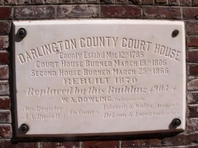 Cornerstone from the fourth courthouse on the site image. Click for full size.