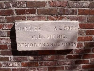 A cornerstone from an earlier courthouse on the site image. Click for full size.
