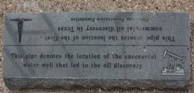 This pipe denotes the location of the successful water well that led to the oil discovery image. Click for full size.
