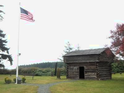 View of the Davis Blockhouse from the Remaining Blockhouses of Central Whidbey Marker image. Click for full size.