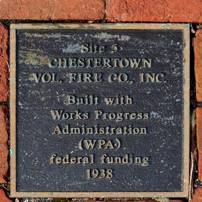 Plaque in the sidewalk in front of the town hall image. Click for full size.