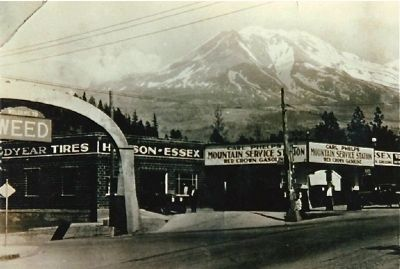 Arch, Gas Station & Mountain, Weed, California: ca. 1930 image. Click for full size.
