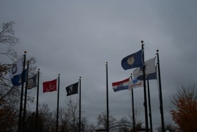 Various flags at memorial image. Click for full size.