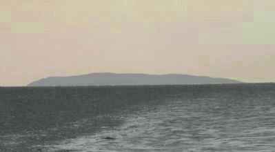 "Corregidor Island (""the Rock""), viewed from the Sun Cruises ferry on Manila Bay - image. Click for full size."