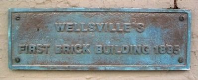 Wellsville's First Brick Building Marker image. Click for full size.