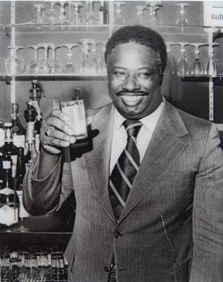 Cornelius Pitts at the bar in his Red Carpet Lounge image. Click for full size.