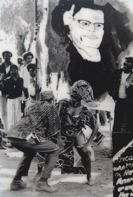 Dancing in Front of Malcom X image. Click for full size.