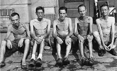 Santo Tomas Internment Camp: emaciated civilians rescued, Feb 1945 image. Click for full size.