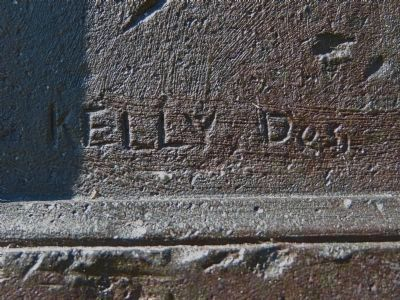 Kelly, Des. (Signature on Plaque) image. Click for full size.