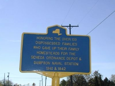 Honoring the Over 100 Dispossessed Families Marker image. Click for full size.