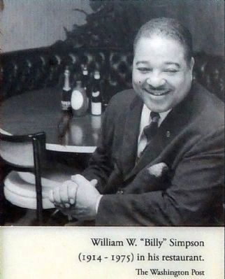 "William W. ""Billy"" Simpson<br>(1914-1975) in his restaurant. image. Click for full size."