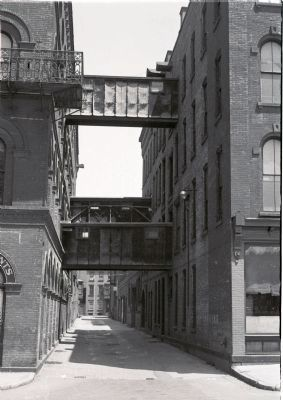 alley between main W & L E Gurley Building and machine shop building to east image. Click for full size.