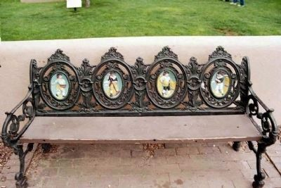 Don Fernando de Taos Plaza bench artwork image. Click for full size.