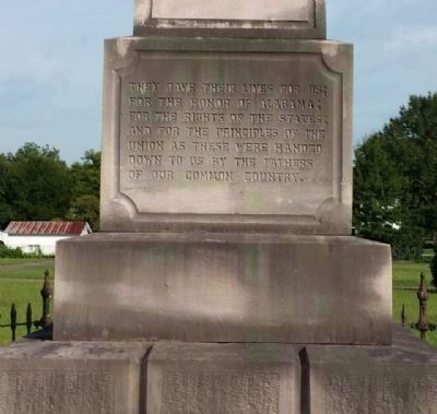 Monument detail (left side) image. Click for full size.