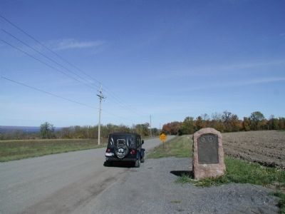 Sullivan and Clinton Marker in situ facing west image. Click for full size.