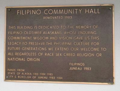 """Filipino Community Center, Renovated 1983 ... "" - plaque on the wall facing Manila Square image. Click for full size."
