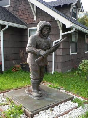 Close-up of the Alaska Native Soldier Statue at the Veteran's Memorial in Juneau image. Click for full size.