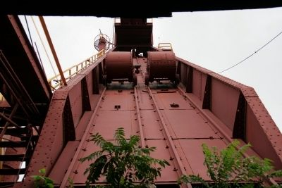 Skip hoist and skip car as seen from the skip pit. image. Click for full size.