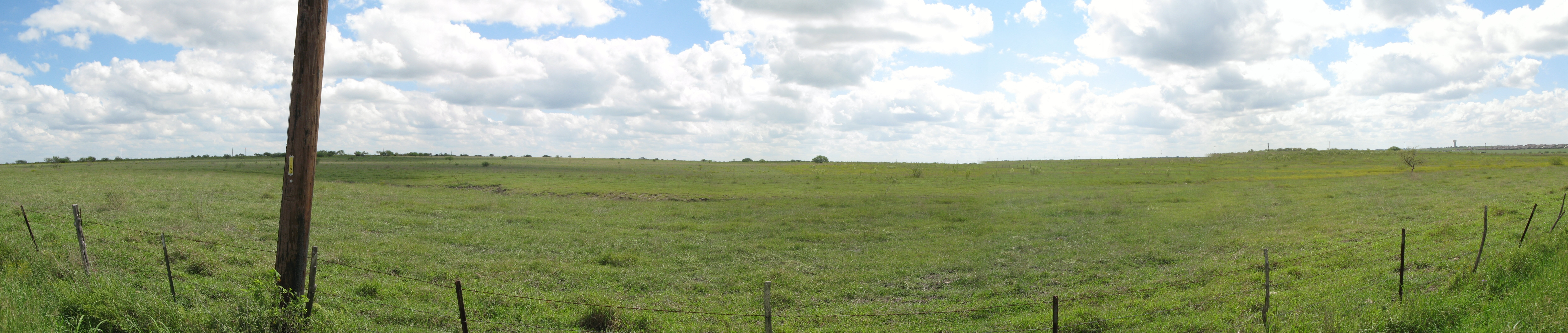 Panorama of where marker was, with ruts somewhat visible from road.