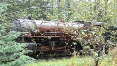 Retired Skagway and White Pass RR steam engine, side-tracked in woods near the terminal image. Click for full size.