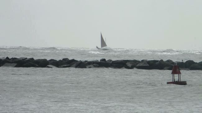 Sailboat in choppy seas, outside the breakwater off Ocean City image. Click for full size.