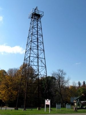 Oil Derrick next to Marker image. Click for full size.