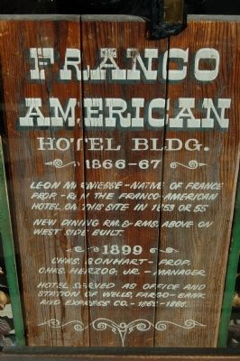Older Franco American Hotel Building Marker in Barber Shop widow. image. Click for full size.