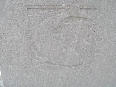 Relief carving of fish on Original Patentees Memorial Marker image. Click for full size.