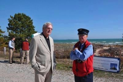 Michigan Historical Commissioner Tom Truscott<br> with DRLPS Founding Director Emeritus Dick Moehl image. Click for full size.