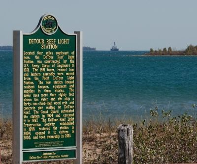Marker with lighthouse in background image. Click for full size.