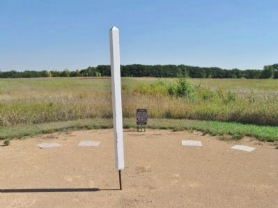 Interpretive Ground Footstep Markers and White Post image. Click for full size.