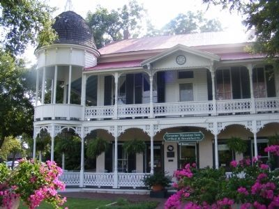 Henry D. Gruene Mansion Inn and his former home image. Click for full size.