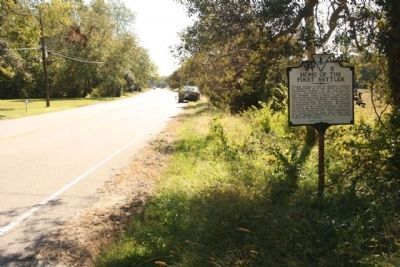 Home of the First Settler Marker, looking south along US 13 Bus. image. Click for full size.