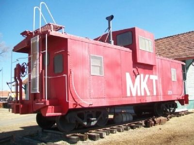 Missouri-Kansas-Texas Caboose at Depot image. Click for full size.